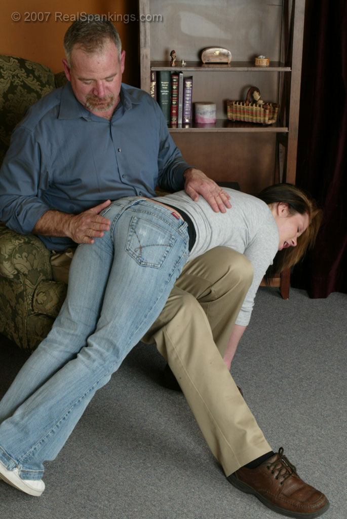 Even at 18 she is not too old for a spanking. Dad takes her over the knee ...