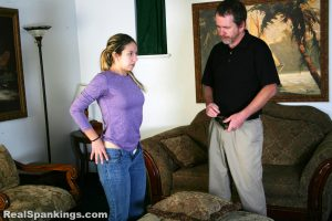 taking off his belt to spank his daughter