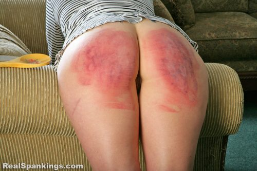 Strapping her already bruised butt